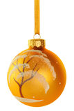 Christmas ball Snow covered tree. Golden yellow Christmas ball with images of snow covered tree hanging on a golden ribbon. Isolated on white background with stock photos
