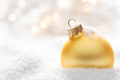 Christmas ball on snow Stock Image