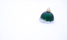 Christmas Ball in snow Royalty Free Stock Image