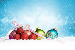 Christmas ball in the snow with merry christmas ribbon Stock Images