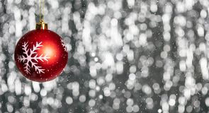 Christmas ball and snow in the night, abstract bokeh lights background, banner,. Copy space stock image