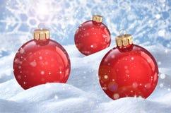 Christmas ball on the snow Stock Photos