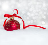 Christmas ball on snow Royalty Free Stock Images
