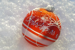Christmas ball in snow Royalty Free Stock Photos