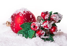 Christmas ball in the snow with rowan Royalty Free Stock Photo