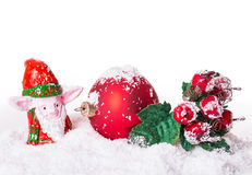 Christmas ball in the snow with rowan Stock Image