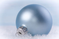 Christmas ball in the snow. Royalty Free Stock Photo