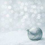 Christmas ball on snow Stock Photos