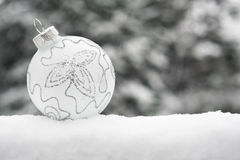 Christmas ball in snowfall Royalty Free Stock Photo