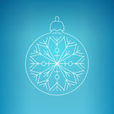 Christmas Ball with Snowflake on a Blue Background Stock Image