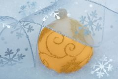 Christmas ball and snowflake decoration on snow Royalty Free Stock Photo