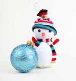 Christmas ball and snowman Royalty Free Stock Images