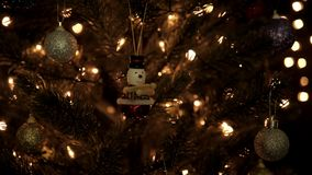 Christmas ball and snowman decoration on tree with bokeh lights in Christmas time.  stock video