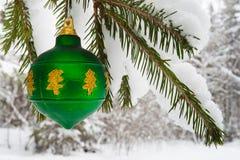 Christmas ball on snowy fir tree Stock Image