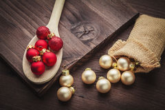 Christmas ball on spoon and jute Stock Images