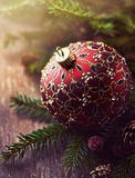Christmas ball on spruce twigs Royalty Free Stock Image