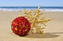 Christmas ball and star on the beach Royalty Free Stock Image