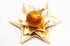 Christmas ball on star shaped plate Royalty Free Stock Photos