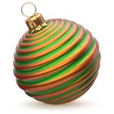 Christmas ball striped green orange New Year`s Eve bauble. Christmas ball striped green orange New Year`s Eve decoration bauble wintertime hanging adornment Stock Photography
