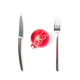 Christmas ball on table with a fork and knife Royalty Free Stock Image