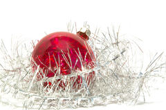 Christmas ball and tinsel. Over white Stock Photos