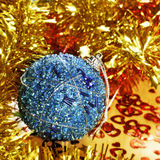 Christmas ball and tinsel Stock Image