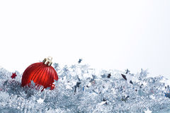 Christmas ball and tinsel Stock Photo