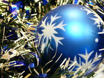 Christmas ball in tinsel Stock Image