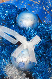 Christmas ball on the tinsel background Stock Photography