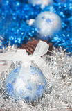 Christmas ball on the tinsel background Royalty Free Stock Photo