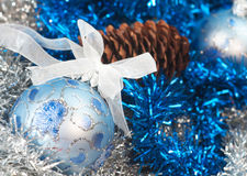 Christmas ball on the tinsel background Royalty Free Stock Images