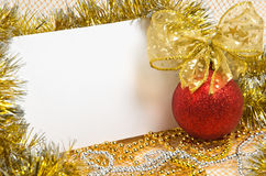 Christmas ball with tinsel and postcard Stock Photo