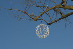 Christmas ball in tree with blue skies Royalty Free Stock Photography