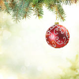 Christmas Ball on the Tree with Blurred Lights. Royalty Free Stock Photos