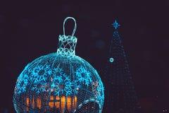 Christmas ball and tree at night Royalty Free Stock Image