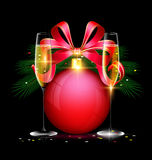 Christmas ball and two glasses. Dark festive background with the large red ball and couple glasses of wine Royalty Free Stock Photography