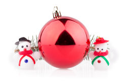 Christmas ball and two snowmen on a white background Stock Photo