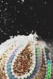 Christmas ball under the snow stock image