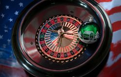 Christmas ball on the wheel of a roulette on a background of the Royalty Free Stock Image