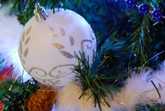 Christmas ball. White decorations on tree christmas royalty free stock images