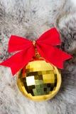 Christmas ball on white fur Stock Image