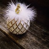 Christmas ball on wood background. White beautiful christmas ball on wood background Royalty Free Stock Images