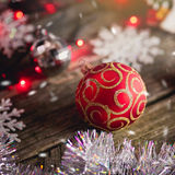 Christmas ball. On the wooden background Stock Photo