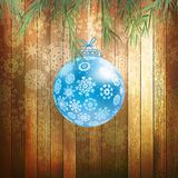 Christmas ball on a wooden background. EPS 10 Stock Images