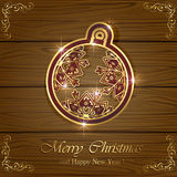 Christmas ball on wooden background Stock Photos