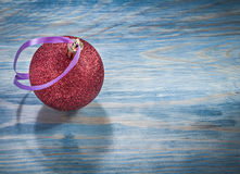 Christmas ball on wooden board holidays concept Stock Image