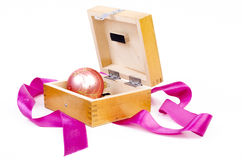 Christmas ball in wooden box as gift Royalty Free Stock Photography