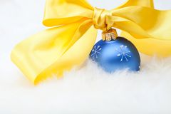 Christmas ball with yellow ribbon bow Stock Photography