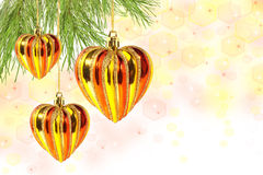 Christmas balls – hearts on pine tree branch Royalty Free Stock Images