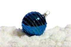 Christmas balls. Blue christmas ball on artifical snow Stock Image
